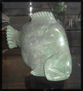 image inuit art statues arctic animals fish
